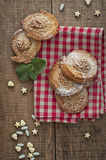 Homemade bakery. Puff cookies with sesame seeds and sugar candies on gingham table cloth Stock Photos
