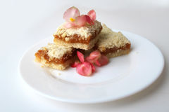 Homemade baking. Appetizing biscuits with pink flowers on a plate Stock Image
