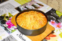 Homemade baking. Apple pie in the form of baking, on the table stock images