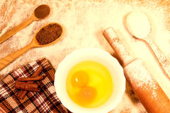 Homemade baking. Kitchen rolling pin, spoon flour, broken eggs, sunflower oil, towel on a chopping Board Stock Photography