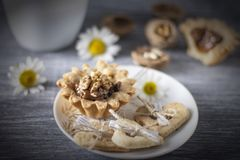 Homemade baking. Shortcake dough baskets with walnuts and condensed milk royalty free stock photos