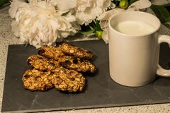 Homemade banana biscuits with milk and white flowers royalty free stock photos