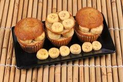 Homemade banana cakes topped sliced banana. Stock Photos