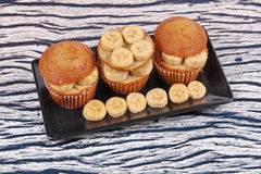 Homemade banana cakes topped sliced banana. Stock Photography