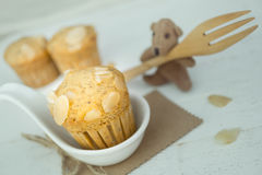 Homemade banana cup cake with sliced almond on wood background stock photo