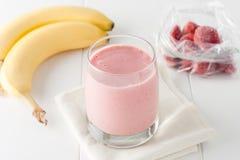 Homemade banana and frozen strawberry smoothie Stock Photo