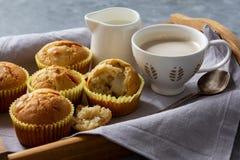 Homemade banana muffins on wooden tray. Homemade banana muffins on wooden tray royalty free stock photos
