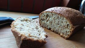 Homemade Banana Nut Bread. Fresh out of the oven with bread knife royalty free stock photo
