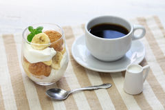Homemade banana pudding and a cup of coffee Royalty Free Stock Photography