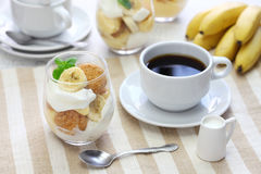 Homemade banana pudding and a cup of coffee Stock Photos