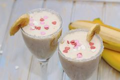 Homemade Banana smoothies or cocktail on wood table stock image