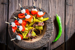 Homemade banderillas with fresh ingredients for spanish corrida. On wooden table Stock Photo