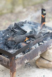 Homemade barbecue grill with fire and smoke Stock Image