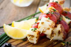 Homemade barbecue haloumi and cherry tomato kebabs. With lemon zest and spring onion, delicious summer meal Royalty Free Stock Photos