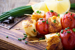 Homemade barbecue haloumi and cherry tomato kebabs. With lemon zest and spring onion, delicious summer meal Royalty Free Stock Image
