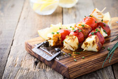 Homemade barbecue haloumi and cherry tomato kebabs. With lemon zest and spring onion, delicious summer meal Royalty Free Stock Photography