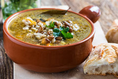 Homemade barley and  lentil soup. In ceramic bowl Royalty Free Stock Images