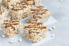 Homemade bars with crispy rice, honey and peanut butter, horizontal, copy space Stock Photos