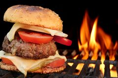 Homemade BBQ Beef Burger On The Hot Flaming Grill Royalty Free Stock Photos