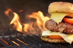 Homemade BBQ Beef Burger On The Hot Flaming Grill stock photo
