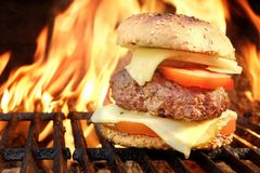 Homemade BBQ Beef Burger On The Hot Flaming Grill Stock Image