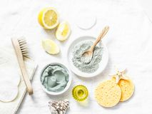 Homemade Beauty Facial Mask. Clay, Lemon, Oil, Facial Brush - Beauty Products Ingredients On Light Background Royalty Free Stock Photo