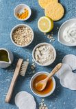 Homemade beauty products concept. Natural moisturizing, nourishing, cleansing face mask - coconut oil, oatmeal, natural yogurt, vi. Tamin E, honey, face brush Stock Photography