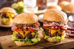 Homemade beef burger, caramelized onion, bacon and beer. Food photography royalty free stock images