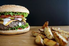 Homemade beef burger and french fries Stock Images