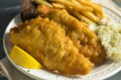 Homemade Beer Battered Fish Fry. With Coleslaw and Chips Royalty Free Stock Photography