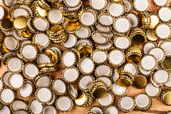 Homemade beer  and bottle caps Royalty Free Stock Photo