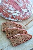 Homemade beetroot sourdough bread. Colored bread on wooden background Royalty Free Stock Image