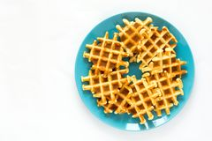 Homemade Belgian waffles on blue plate royalty free stock image