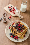 Homemade belgian waffles with fruit and chocolate Royalty Free Stock Images