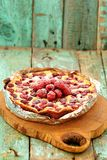 Homemade berry cake with fresh raspberries and icing sugar baked. In foil copyspace Stock Photos