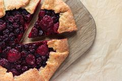 Homemade berry cake. On wooden cutting board stock photo