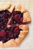 Homemade berry cake. On a kraft baking paper stock image