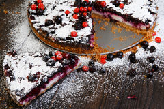 Homemade berry cake on the wood background Stock Photo