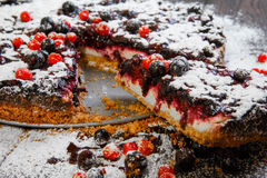 Homemade berry cake on the wood background Royalty Free Stock Photography
