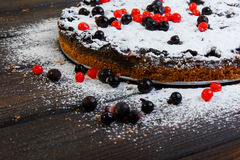Homemade berry cake on the wood table Stock Image