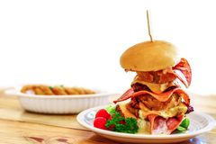 Homemade big burger. On wooden table Royalty Free Stock Photography