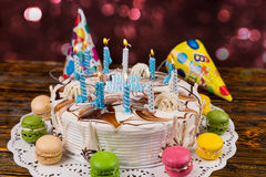 Homemade birthday cake with lots of burning candles and holiday Royalty Free Stock Image