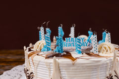 Homemade birthday cake with lots of extinguished candles Royalty Free Stock Image