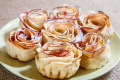 Homemade biscuit with apples in the form of rose on plate. Shallow depth of field Stock Images