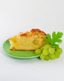 Homemade biscuit cake with green grapes Stock Photos