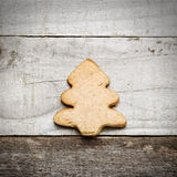 Homemade biscuit in Christmas tree shape on wooden background Stock Photo