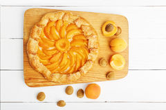 Homemade biscuit pie with peaches on white wooden table. Royalty Free Stock Photography