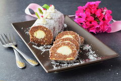 Homemade biscuit roll with coconut filling without baking sliced. Royalty Free Stock Photos