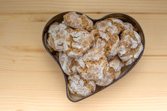 Homemade biscuits amaretti in tin form of heart Royalty Free Stock Images