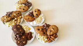 Homemade biscuits. Biscuits chocolate chips, almonds, hazelnuts, coconut Royalty Free Stock Photography